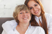 Portrait of a mature grandmother and teen granddaughter and teen — Stock Photo