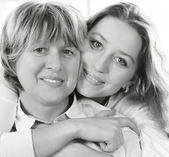 Black and white close up portrait of a mature mother and adult d — Stock Photo