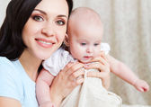 Happy smiling mother with six month old baby girl — Foto Stock