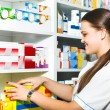 Stock Photo: Female pharmacist at drugstore