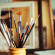 Close up of painting brushes in studio of artist — Stock Photo #38301993