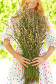 Romantic woman with long blond hair with lavender bouquet — Stock Photo