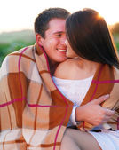 Young happy couple in love in summer day — Stock Photo