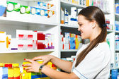 Female pharmacist at the drugstore — Stock Photo