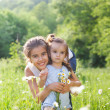 Two happy sisters in the spring field — Stock Photo