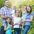 Happy young family with four children outdoors — Stock Photo #38666479