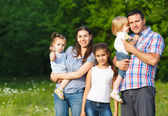 Happy young family with children — Foto Stock