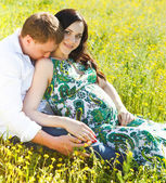 Young happy couple in love in the flowering spring park — Stock Photo