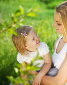 Happy mother and her little daughter in the spring — Stock Photo