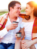 Young happy couple in love at the summer picnic — Stock Photo
