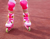 Rollerblades inline skates of a child closeup in action outdoors — Stock Photo