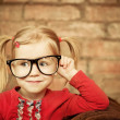 Stock Photo: Funny little girl with glasses