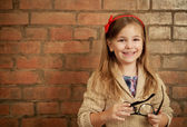 Funny little girl with glasses — Stock Photo