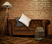 Interior of loft with velvet sofa — Stock Photo