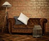 Interior of loft with velvet sofa — Stock Photo