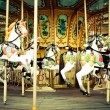 Horses on a carnival Merry Go Round — Stock Photo #40467437