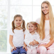 Mother and daughters playing in the bedroom in the Mother's Day — Stock Photo #40467457