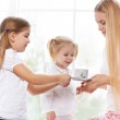 Mother and daughters playing in the bedroom in the Mother's Day — Stock Photo #40467461