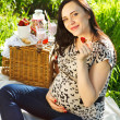 Pregnant woman at picnic in the spring park — Stock Photo #40467519