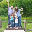 Stock Photo: Happy young family with four children