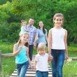 Happy young family with four children — Stock Photo