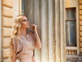 Beautiful blond woman in beige long dress  — Stock Photo