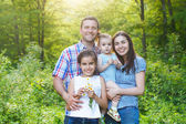 Happy young family with children — Stock Photo