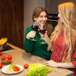 Two beautiful young women friends drinking red wine together — Stock Photo