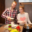 Stock Photo: Happy couple cooking pasta
