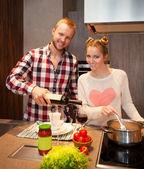 Happy couple cooking pasta — Stock Photo