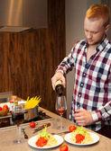 Handsome man cooking at home preparing pasta — Photo