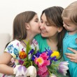 Happy woman and her little daughters in the living room — Stock Photo #44974847