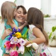 Happy woman and her little daughters in the living room — Stock Photo #44974857