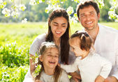 Happy young family with two children outdoors — Stock Photo
