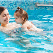 One year baby girl at her first swimming lesson with mother  — Stok fotoğraf #45397001