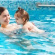 One year baby girl at her first swimming lesson with mother  — 图库照片 #45397001