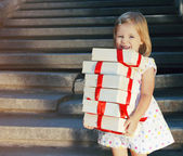 Gift boxes in the hands of little cute girl  — Stock Photo