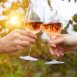 Young happy couple enjoying a glasses of pink wine — Stock Photo #45751571