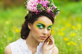 Portrait of a young girl with creative spring make up — Stock Photo