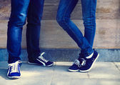 Close up of a teen couple wearing shoes  — Stock Photo