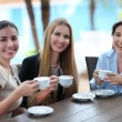 Young women drinking coffee in a cafe outdoors — Stock Photo #47787713
