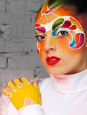 Beautiful young model with bright creative make up with helmet — Stok fotoğraf