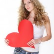Blond girl with big valentine card — Stock Photo #4818296