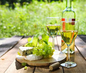Cheese, grapes and two glasses of the white wine  — Stock Photo