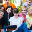 Young college students using tablet computer — Stock Photo #49788993