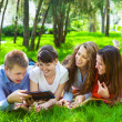 Young college students using tablet computer — Stock Photo #49789015