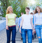 Group of teenagers walking outdoors — Stock Photo