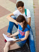 Students or teenagers with notebooks outdoors — Foto Stock