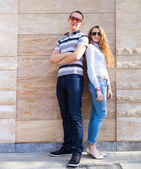 Young couple standing back to back  — Foto de Stock