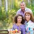 Happy family with daughter on autumn picnic — Stock Photo